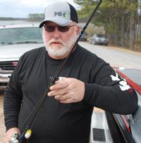 Freddy Riley holding a fishing rod